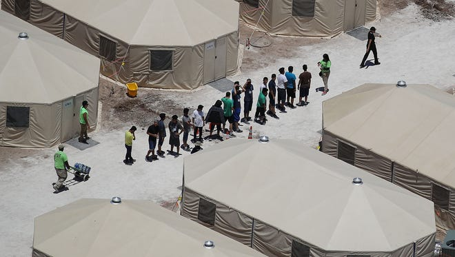 Children and workers are seen at a tent encampment recently built near the Tornillo Port of Entry on June 19, 2018 in Tornillo, Texas. The Trump administration is using the Tornillo tent facility to house immigrant children separated from their parents after they were caught entering the U.S. under the administration's zero tolerance policy.