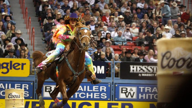 Fallon Taylor of Whitesboro, Texas rides during the first go-round of the Wrangler National Finals Rodeo in Las Vegas Thursday, Dec. 4, 2014. Taylor's time was the best of the night at 14.09 seconds. (AP Photo/Las Vegas Sun, Steve Marcus)  LAS VEGAS REVIEW JOURNAL OUT