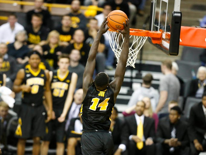 Iowa junior guard Peter Jok dunks the ball against