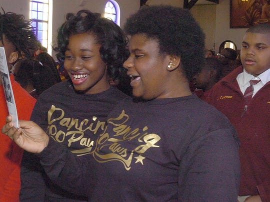 Students attending the Martin Luther King, Jr. celebration Monday at Holy Ghost Catholic Church sing a spiritual song to begin the celebration. See more photos at dailyworld.com and on Facebook.