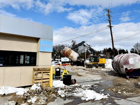 Keystone Petrolium workers demolish the large tank