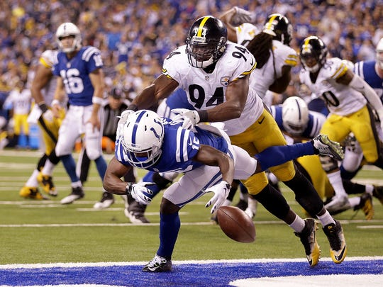 Indianapolis Colts wide receiver Phillip Dorsett (15) drops a pass in the end zone on a 4th down play as he is defended by Pittsburgh Steelers inside linebacker Lawrence Timmons (94) in the second half.