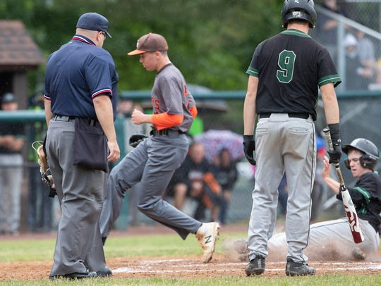 Raritan's Ryan Kasmer slides into home as he scores on a wild pitch in the third inning.