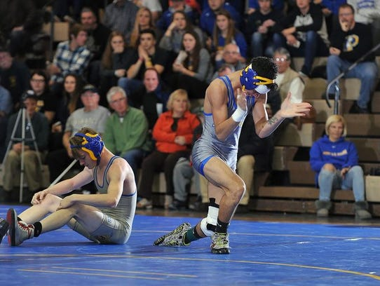 Buena's Junior LaPortez (right) reacts after pinning