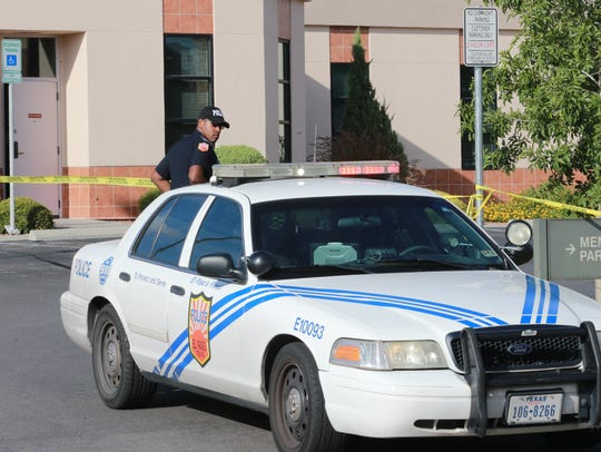 El Paso police guard the scene of a bank robbery Monday