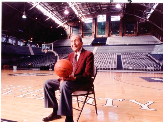 Tony Hinkle sits in Hinkle Fieldhouse named in his