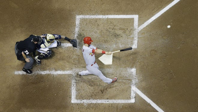 St. Louis Cardinals' Matt Carpenter hits a home run during the third inning Wednesday in Milwaukee.
