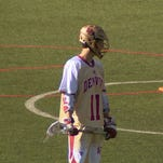Jack Bobzien awaits a face-off for the Denver Pioneers Lacrosse Team