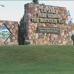 "Fort Carson officials say one person has been detained after acting in a ""suspicious and threatening"" way on the infantry post outside Colorado Springs, but no one was hurt and no weapon was found."
