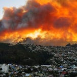 View of houses in flames during a fire in Valparaiso,west of Santiago, Chile, on April 12, 2014.