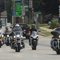 A group of motorcyclists head out of Waupun, Saturday, on a patriotic scavenger hunt, supporting Hero's Hunt For Wounded Warriors. Individuals and groups of riders left the Celebrate Waupun festival grounds for the 114-mile trip, which took around 3 hours. Saturday.