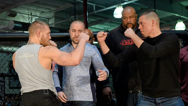 UFC featherweight champion Conor McGregor, left, and lightweight contender Nate Diaz will meet Saturday in Las Vegas.