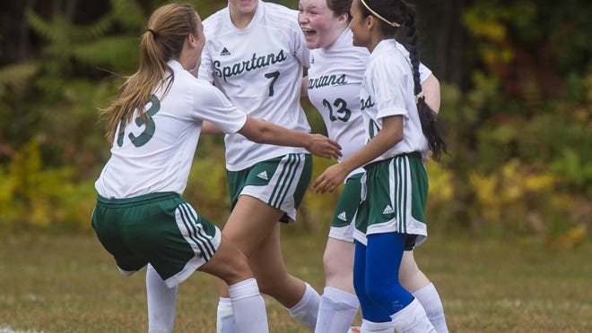 Winooski's Taylor Langlais (23) celebrates with teammates after her goal against Richford during Wednesday's girls soccer game in Winooski. The Spartans won 3-1.
