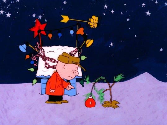 Title: CHARLIE BROWN TRIES TO PERK UP THE FORLORN LITTLE CHRISTMAS TREE