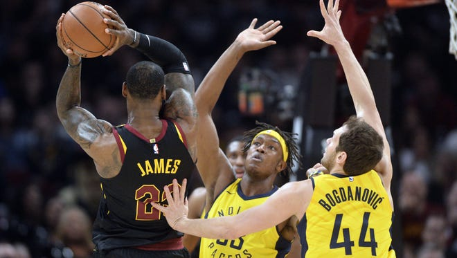 Indiana Pacers center Myles Turner (33) and forward Bojan Bogdanovic (44) defend Cleveland Cavaliers forward LeBron James (23) during the first half in game seven of the first round of the 2018 NBA Playoffs at Quicken Loans Arena.