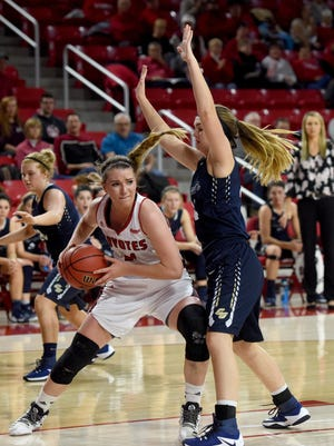 USD's Ciara Duffy drives toward the basket while Concordia St. Paul's Brianna Miller defends during their game at Sanford Coyote Sports Center at the University of South Dakota in Vermillion on Wed., Nov. 30, 2016.