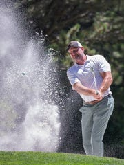 Trent Dilfer hits out of a sandtrap on 13th hole during the American Century Championship at Edgewood Tahoe Golf Course in Stateline, on Sunday.