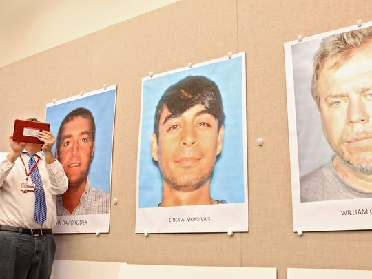 From left, photos of David Yoder of Desert Hot Springs, Erick Monsivais of Los Angeles, and William Thompson of Las Vegas are displayed during a press conference announcing that child pornography and human trafficking charges have been filed against the three.