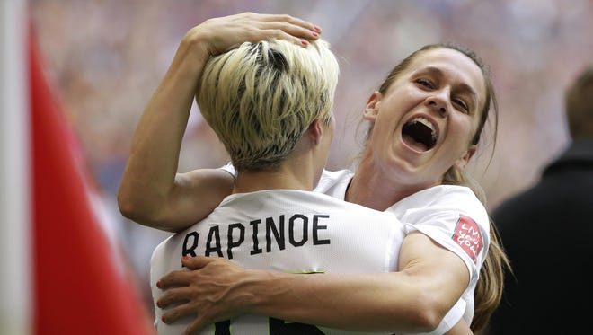 United States' Heather O'Reilly, right, hugs Megan Rapinoe (15) after the U.S. beat Japan 5-2 in the FIFA Women's World Cup soccer championship in Vancouver, British Columbia, Canada, Sunday, July 5, 2015. (AP Photo/Elaine Thompson)