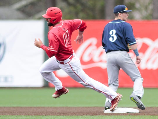 UL's Alex Pinero rounds second on a St. Peters error