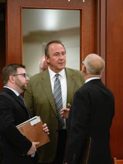 Former Utah Attorney Gen. Mark Shurtleff, center, facing public corruption charges, appears in Judge Elizabeth Hruby-Mills courtroom in Salt Lake City on Sept. 28, 2015, for a pre-trial hearing.