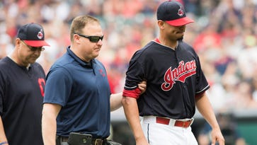 Cleveland Indians' Carlos Carrasco struck on pitching arm by line drive in loss to Minnesota Twins