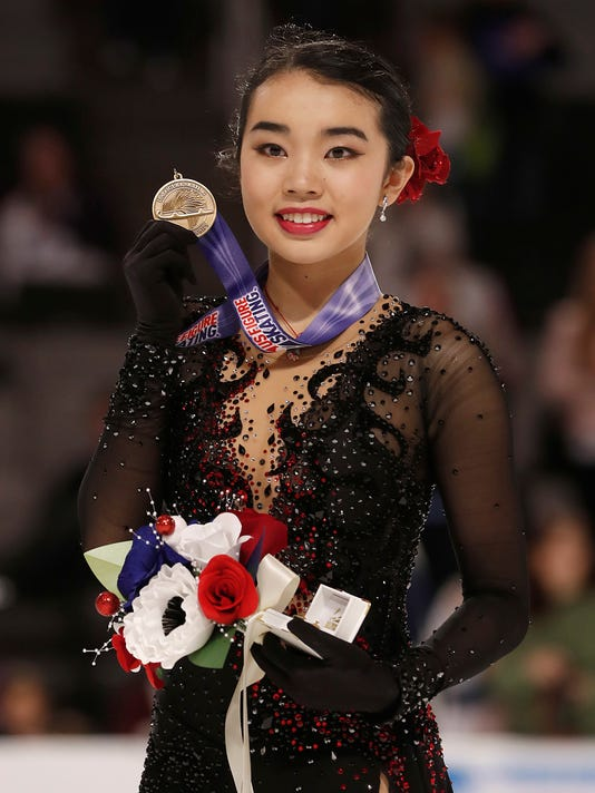 Karen Chen poses after finishing third at the women's free skate event at the U.S. Figure Skating Championships in San Jose, Calif., Friday, Jan. 5, 2018. (AP Photo/Tony Avelar)