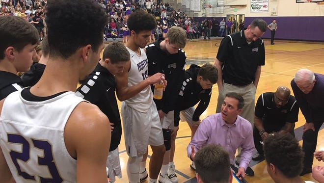 North Kitsap boys basketball coach Scott Orness talks to his team heading into the fourth quarter of Saturday's district quarterfinal game against Franklin Pierce. The Vikings won 70-55 to clinch a regional berth.