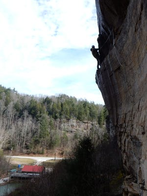 Climbing the via ferrata at Torrent Falls Climbing Adventure in Kentucky's Red River Gorge.