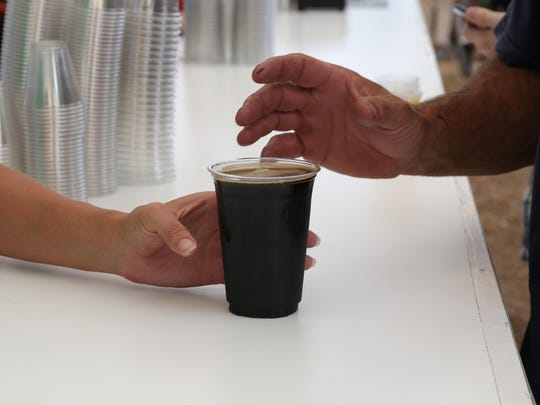Cortney Thede of Waukee delivers a glass of porter