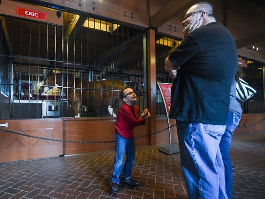Denver Nothnagel, left, speaks to his parents while