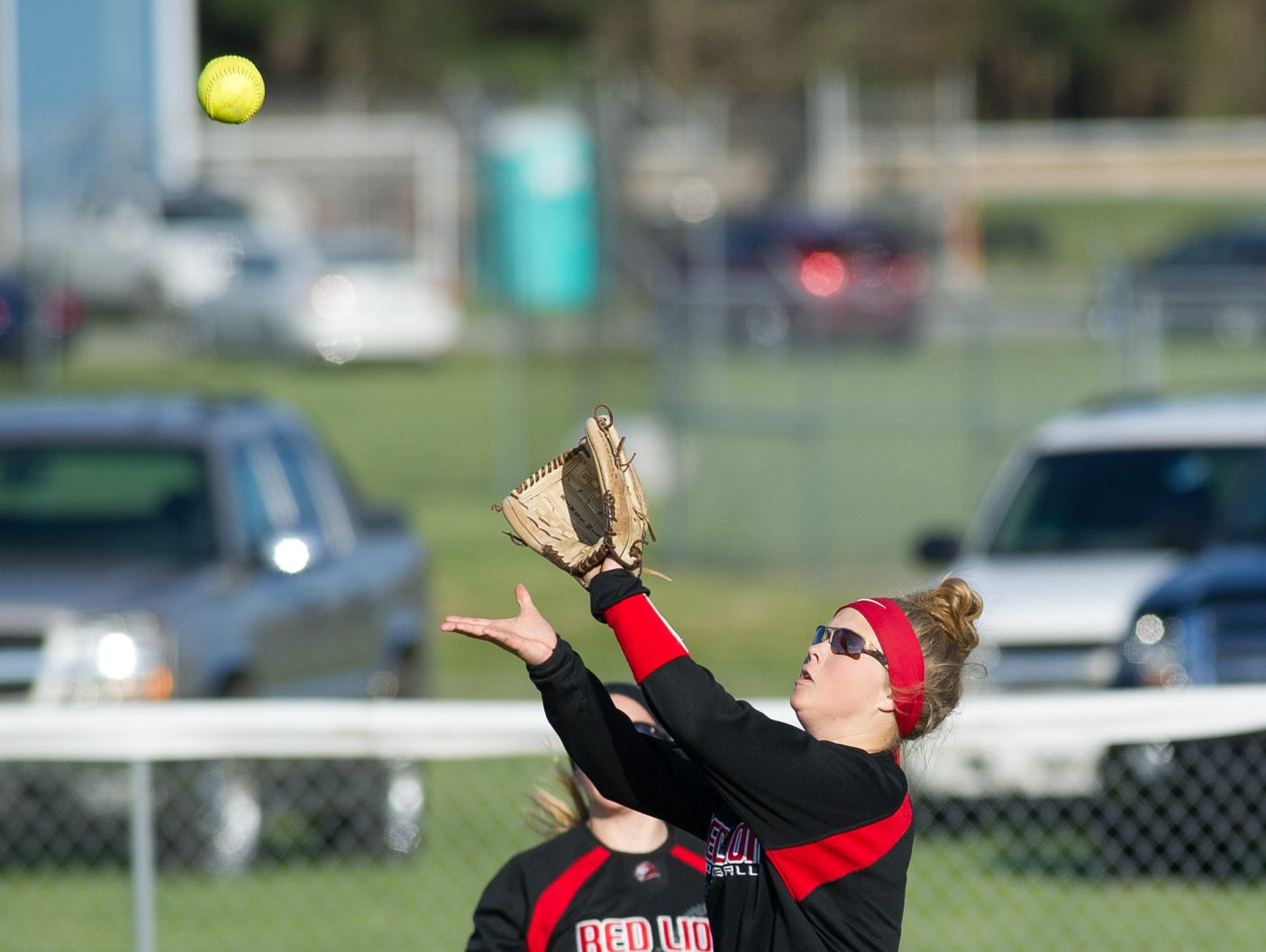 Red Lion's outfielder Julia Thuer (4) makes a catch in the outfield in their game against Lake Forest.
