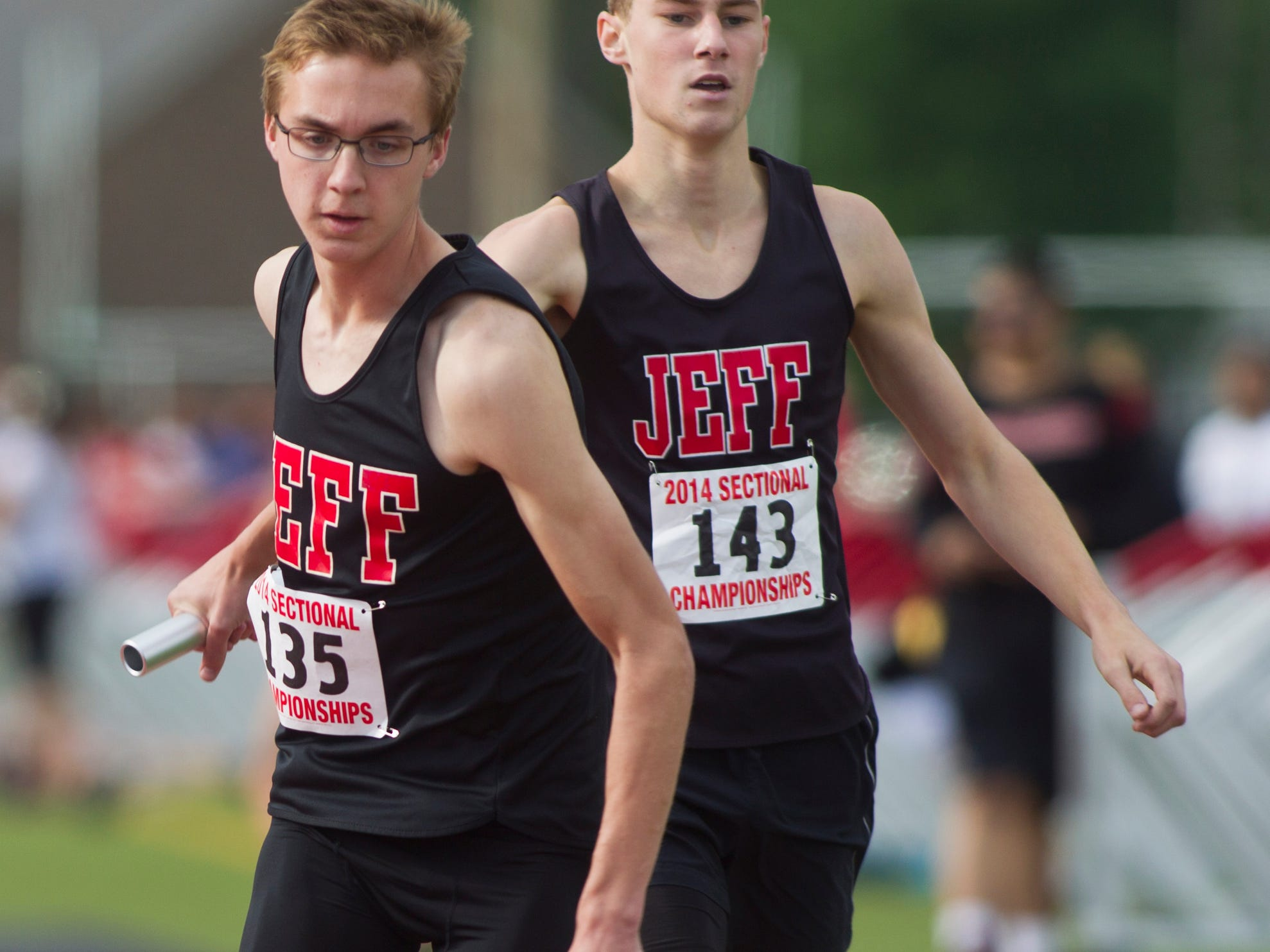Lafayette Jeff's Daniel Feltis receives the baton from teammate Shane Shipley during the 3,200 meter relay at last year's sectional.