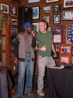 "Krazy George, right, cheers on singer Tyrone ""Lil Usher"" Maxwell during a recent night of Krazy George karaoke at Hub Stacey's downtown. Maxwell sang and danced while performing ""Yeah"" by Usher."