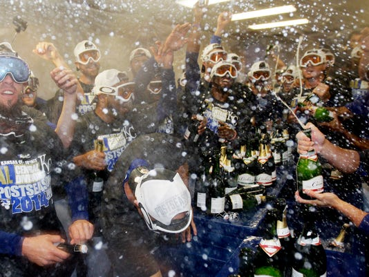 Kansas City Royals players and coaches celebrate after the Royals defeated the Chicago White Sox 3-1 in a baseball game in Chicago on Friday, Sept. 26, 2014. (AP Photo/Nam Y. Huh)