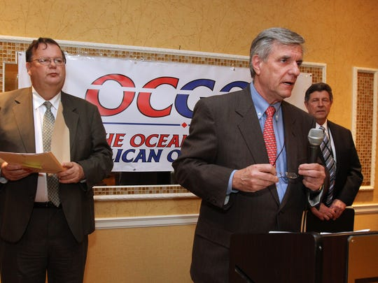 Freeholder Jack Kelly (left) listens to Ocean County Republican Chairman George Gilmore (center) speak at the county's GOP convention at the Toms River Hotel on March 19, 2014.