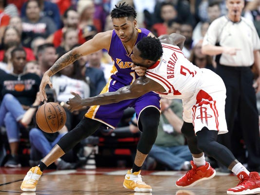 Houston Rockets' Patrick Beverley (2) knocks the ball away from Los Angeles Lakers' D'Angelo Russell (1) during the second half of an NBA basketball game Wednesday, March 15, 2017, in Houston. The Rockets won 139-100. (AP Photo/David J. Phillip)