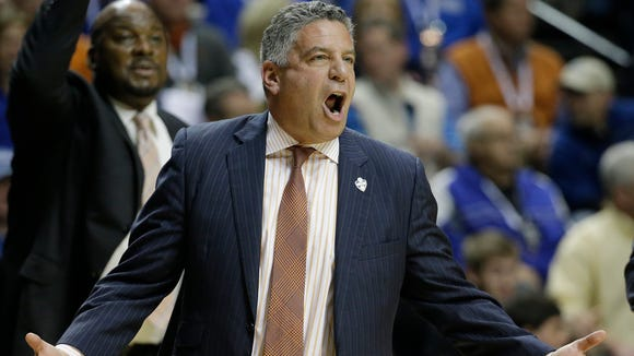 Auburn head coach Bruce Pearl speaks to his players during the first half of an NCAA college basketball game in the quarter final round of the Southeastern Conference tournament against the LSU, Friday, March 13, 2015, in Nashville, Tenn.