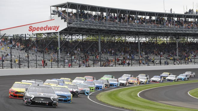 NASCAR driver Kevin Harvick leads the field through the first turn on the start of the NASCAR Brickyard 400 auto race at the Indianapolis Motor Speedway, Sunday, Sept. 8, 2019, in Indianapolis.