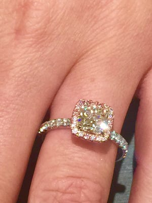 Forever Mark cushion cut center stone surrounded by a halo of pink diamonds set in 14KT white gold.
