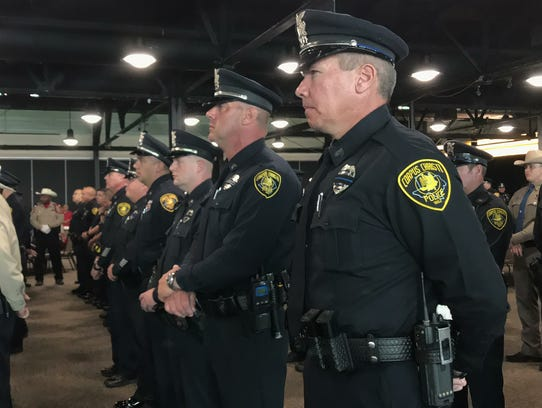 Corpus Christi Police Department officers stand during