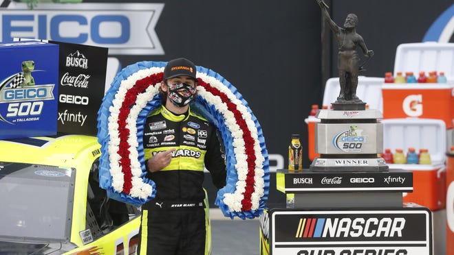Ryan Blaney celebrates in Victory Lane after winning a the NASCAR Cup Series  race at Talladega Superspeedway on Monday.