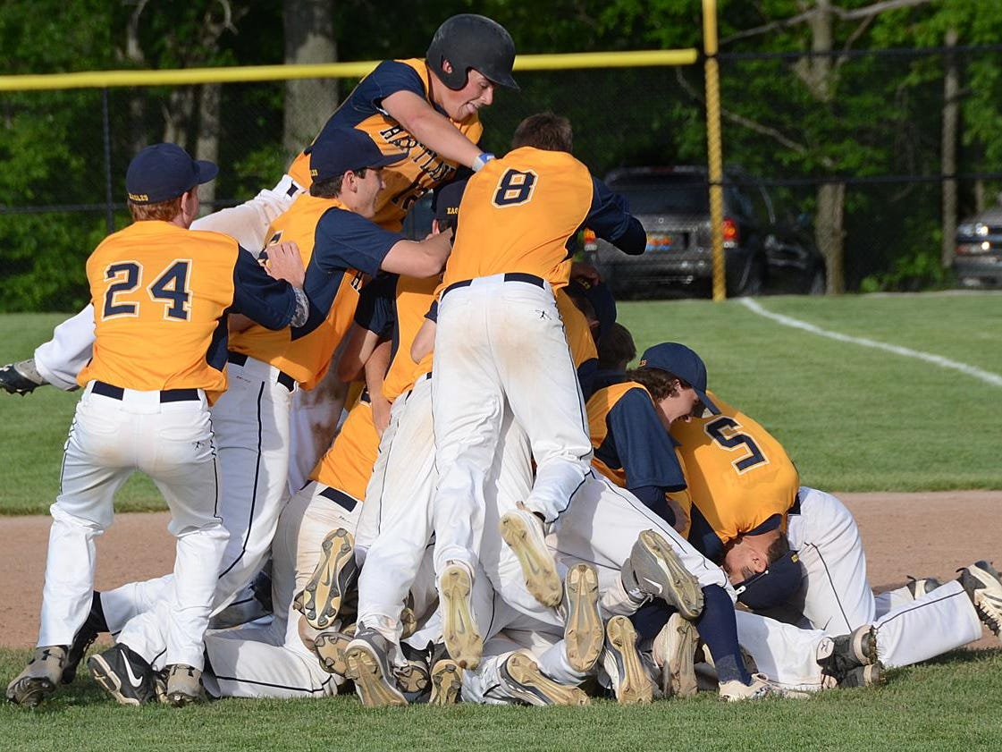 Hartland players, shown celebrating a walk-off win on Monday, did the same on Saturday, mobbing Max Cadman after a game-winning hit in the regional semifinal. The Eagles rallied to beat Detroit Catholic Central in the championship game, winning their first regional title since 2012.