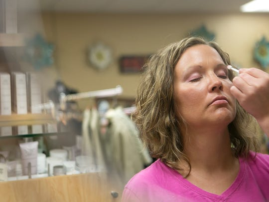 Peggy Machtan has her makeup done by Katie Dahlke at Merle Norman Cosmetics and Day Spa in Marshfield.