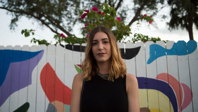 """Taylor Komara, of Stuart, painted a mural titled """"A Rhythm in Nature"""", focusing on organic shapes and color."""