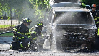 Paramus firefighters put out car fire at a Honda facility on Pleasant Ave in Paramus on Monday morning June 18, 2018. A service technician for Honda just conducted a test drive of a newly acquired trade-in Volkswagen Routan minivan at their off-site facility according Bruce Laga, Honda Service Manager. The technician brought the minivan onto the lift when he noticed smoke coming from the engine area. Laga said the technician quickly moved the vehicle out from the building and by the time he went to get a fire extinguisher it was too late the car was already fully engulfed in flames. No injuries were reported.
