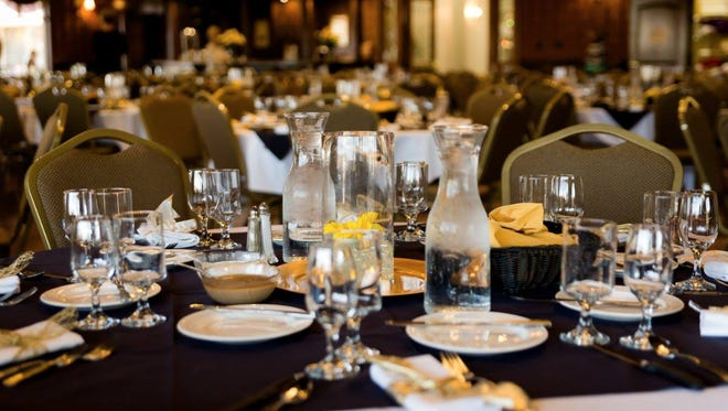 A table is set for DOVE Center's 2017 gala in the SunRiver Ballroom