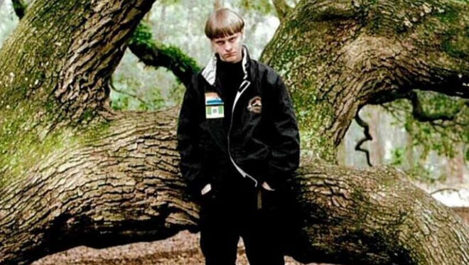 In a self-portrait taken shortly before his June 2015 attack on Emanuel African Methodist Episcopal Church in Charleston, S.C., Dylann Roof poses in front of the Angel Oak near Charleston, a tree believed to be hundreds of years old. The patches on his jacket are flags of the defunct states of Rhodesia and apartheid South Africa, popular symbols among white supremacists.