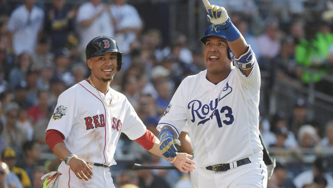 Royals catcher Salvador Perez, right, celebrates his home run with Red Sox outfielder Mookie Betts.