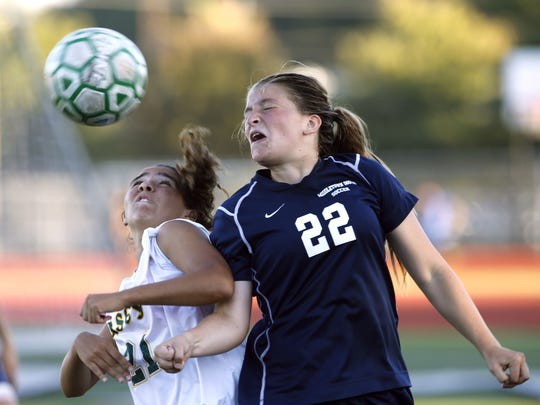 Juliana Rafaniello (21) of Red Bank Catholic  defends against Emily McCarthy (22) of Middletown South during girls high school soccer game at Count  Basie Park, Red Bank,NJ. Wednesday, October 4, 2017.  Noah K. Murray-Correspondent Asbury Park Press